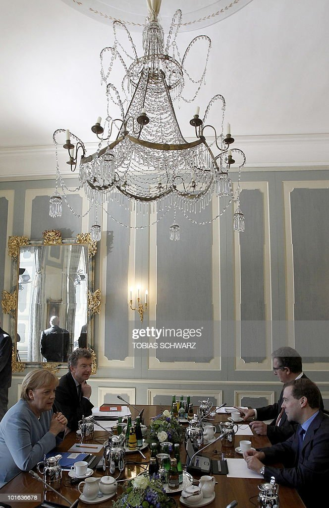 German Chancellor Angela Merkel talks with Russian President Dmitry Medvedev before bilateral talks at the government guest house Schloss Meseberg, some 70 kilometres (43.5 miles) north of Berlin, June 5, 2010. Medvedev is in Germany for two days of what the German government called 'informal' discussions set to be dominated by Iran's nuclear programme and the Middle East.