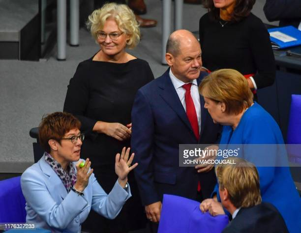 German Chancellor Angela Merkel talks with the leader of the Christian Democratic Union and Defence Minister Annegret KrampKarrenbauer as German...
