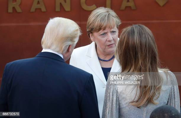 German Chancellor Angela Merkel talks with US President Donald Trump and US First Lady Melania Trump as they arrive for a concert of the La Scala...
