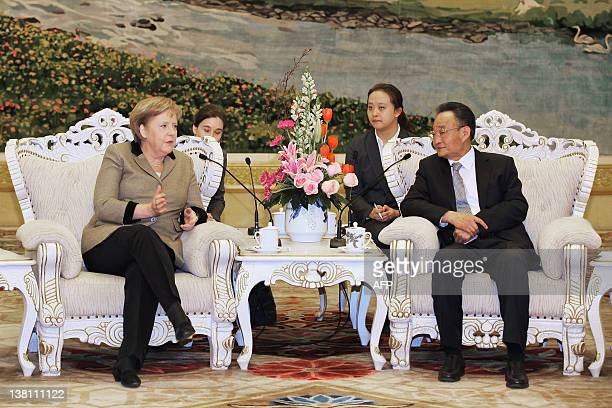 German Chancellor Angela Merkel talks with Wu Bangguo head of China's legislature at the Great Hall of the People on February 3, 2012 in Beijing....