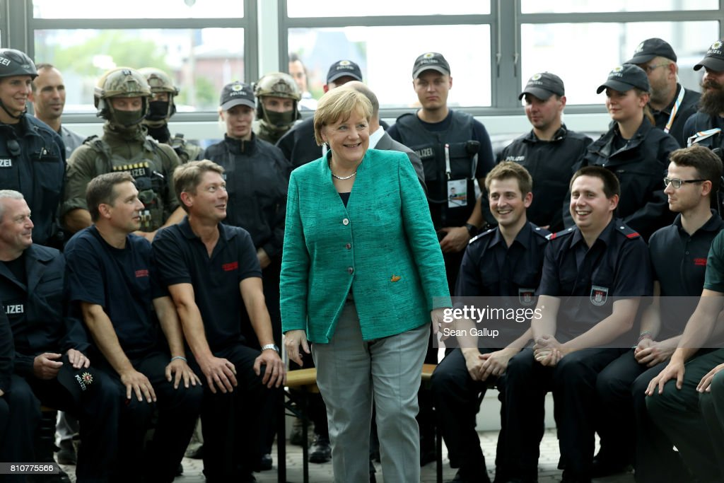 German Chancellor Angela Merkel thanks members of German law enforcement and emergency services at the conclusion of the G20 economic summit on July 8, 2017 in Hamburg, Germany. Severe rioting by anti-G20 activists that included looting, arson and physical attacks against police overshadowed the two-day summit.