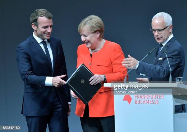 German Chancellor Angela Merkel the French President Emmanuel Macron and Heinrich Riethmueller the president of German Publishers and Booksellers...