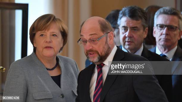 German Chancellor Angela Merkel the leader of Germany's social democratic SPD party Martin Schulz German Vice Chancellor and Foreign Minister Sigmar...