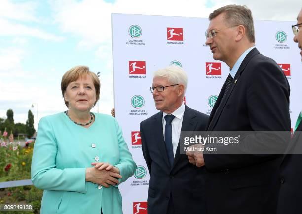 German Chancellor Angela Merkel , the President of the German Football League Reinhard Rauball and President of the German Football Association...