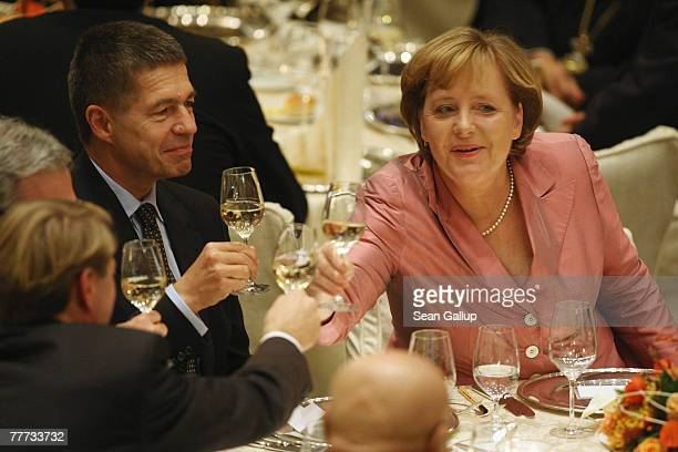 German Chancellor Angela Merkel toasts with her husband Joachim Sauer and other guests after she received the Leo Baeck Award at the Adlon Hotel...