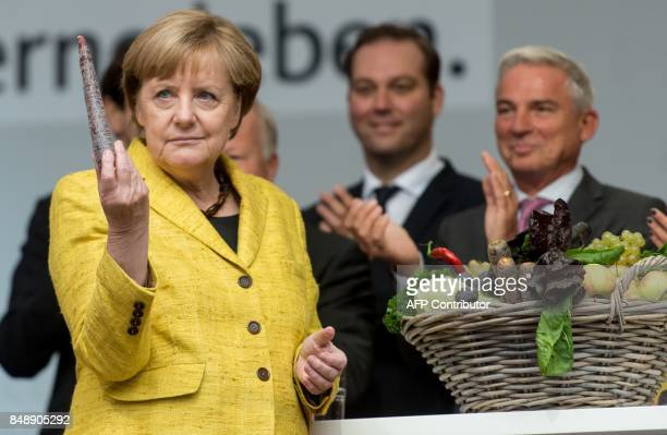 German Chancellor Angela Merkel top candidate of her conservative Christian Democratic Union party for upcoming general elections inspects a basket...