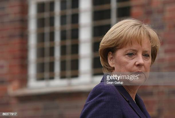 German Chancellor Angela Merkel tours the former prison of the East German communistera secret police known as the Stasi at Hohenschoenhausen on May...