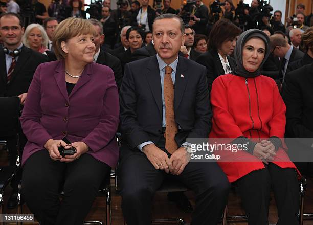 German Chancellor Angela Merkel Turkish Prime Minister Recep Tayyip Erdogan and Erdogan's wife Emine Erdogan arrive for a celebration to mark 50...