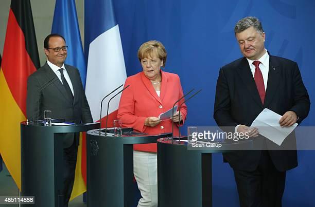German Chancellor Angela Merkel Ukrainian President Petro Poroshenko and French President Francois Hollande arrive to speak to the media following...