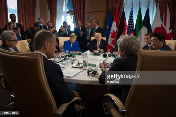German Chancellor Angela Merkel US President Donald Trump and British Prime Minister Theresa May hold discussions after signing a declaration on...
