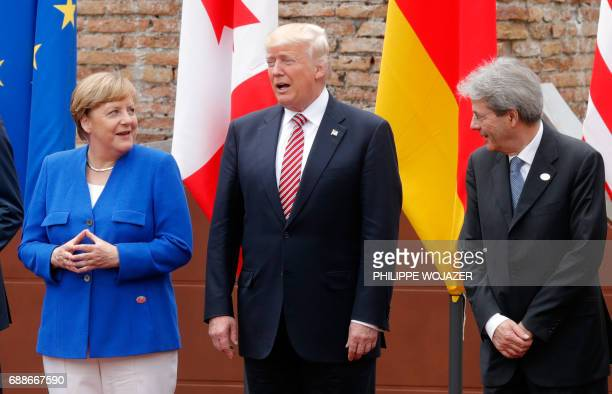 German Chancellor Angela Merkel US President Donald Trump and Italian Prime Minister Paolo Gentiloni pose for a family picture as they attend the...
