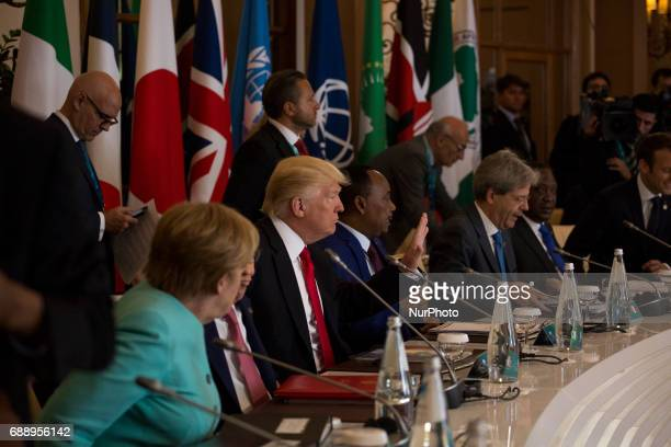 German Chancellor Angela Merkel US President Donald Trump italian Prime Minister Paolo Gentikoni and French President Emmanuel Macron during the G7...