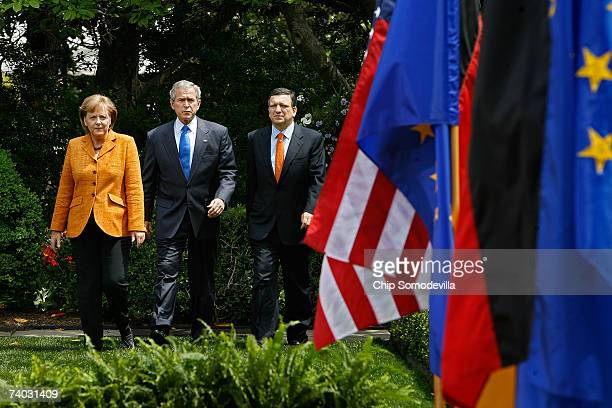 German Chancellor Angela Merkel US President George W Bush and European Commission President Jose Manuel Barroso walk into the Rose Garden for a...
