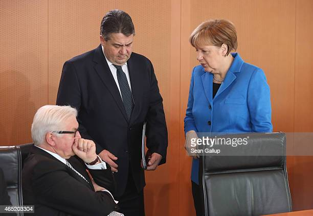 German Chancellor Angela Merkel Vice Chancellor and Economy and Energy Minister Sigmar Gabriel and Foreign Minister FrankWalter Steinmeier chat prior...