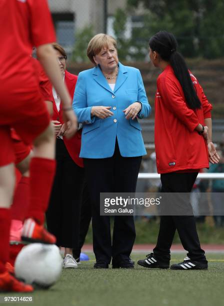 German Chancellor Angela Merkel visits a program to encourage integration of children with foreign roots through football at the SV RotWeiss Viktoria...