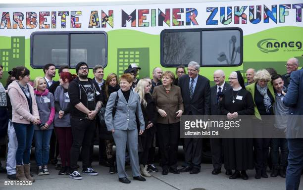 German Chancellor Angela Merkel visits on March 22 2016 the Catholic institution for underprivileged youths in Berlin's Marzahn The Salesian center...