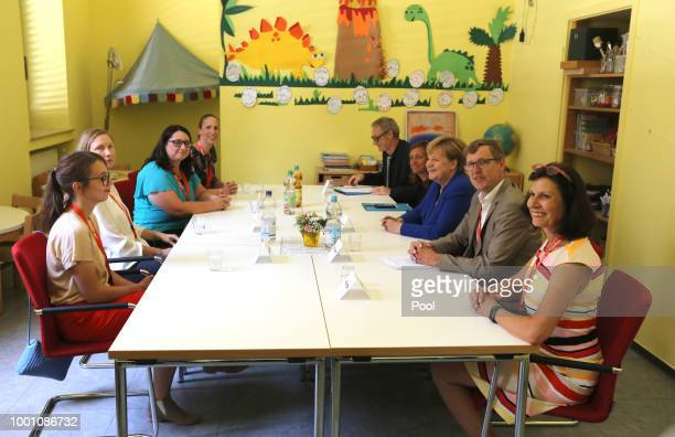 German Chancellor Angela Merkel visits the Caritas Centre Kalk and talks with child care workers and parent associates on July 18 2018 in Cologne...