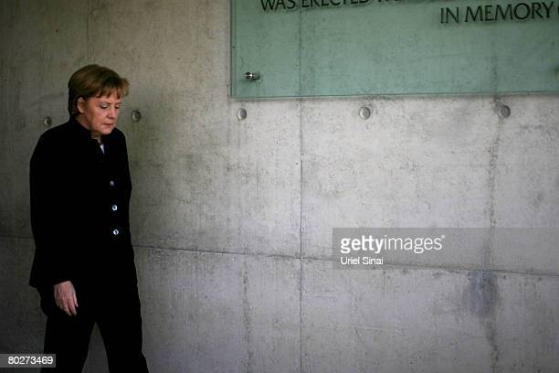 German Chancellor Angela Merkel visits the Children's Memorial at the Yad Vashem Holocaust Memorial on March 17 2008 in Jerusalem Israel Merkel is on...