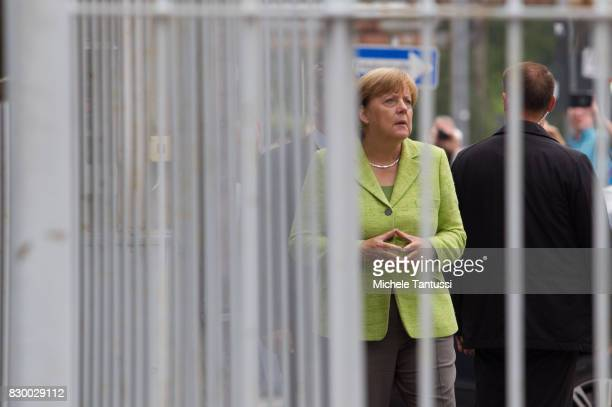 German Chancellor Angela Merkel visits the former prison of the East German communistera secret police or Stasi at Hohenschoenhausen on August 11...