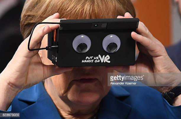 German Chancellor Angela Merkel visits the ifm electronics stand at hall 9 at the Hannover Messe industrial trade fair on April 25 2016 in Hanover...
