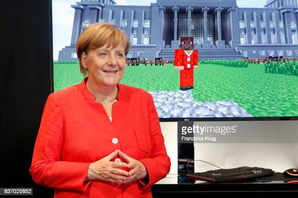 German Chancellor Angela Merkel visits the Microsoft stand during a tour through the gamescom halls at the Gamescom 2017 gaming trade fair during the...