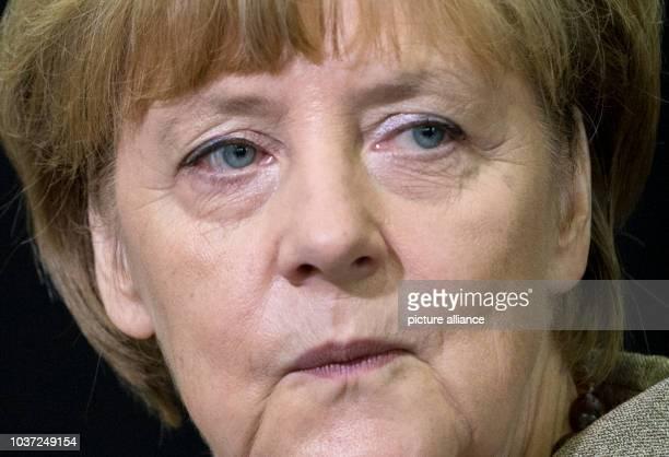 German Chancellor Angela Merkel visits the PraelatDiehlSchool in GrossGerau Germany 30 September 2014 Photo BORIS ROESSLER/DPA | usage worldwide