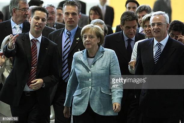 German Chancellor Angela Merkel visits the Volkswagen plant next to Volkswagen' s CEO Martin Winterkorn and the president for Volkswagen in Brazil...