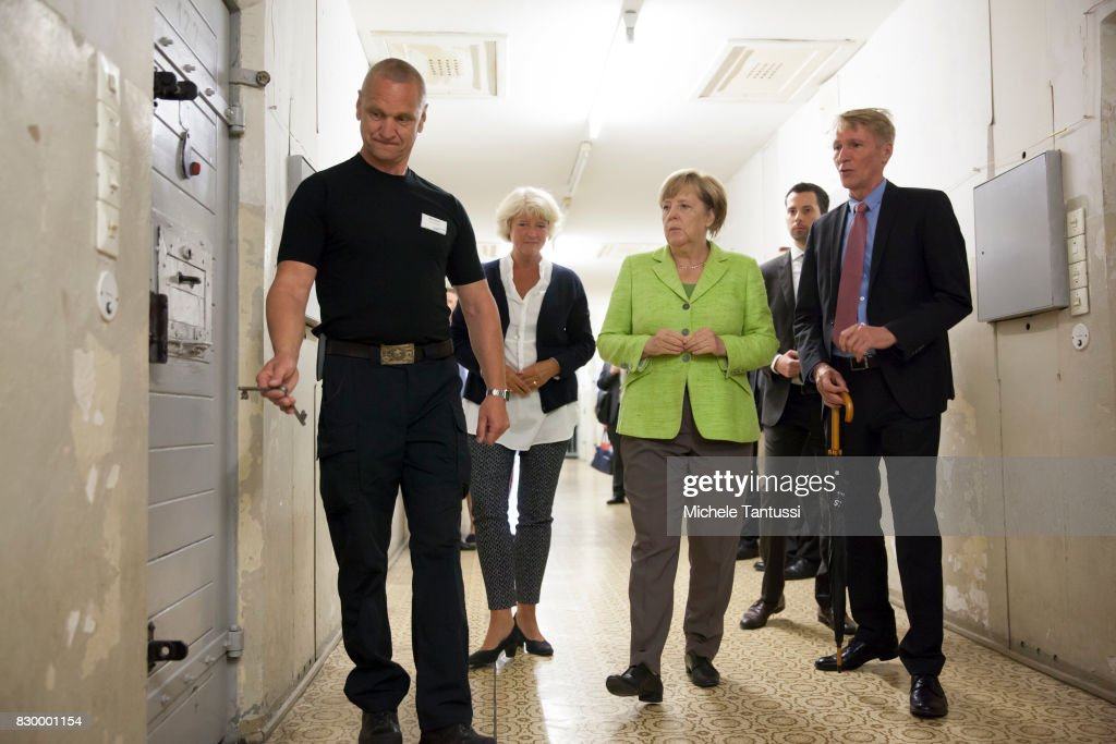 German Chancellor Angela Merkel visits with Monika Gruetters federal commissioner for Culture and Media and Hubertus Knabe Director of the Stasi Prison memorial, the former prison of the East German, communist-era secret police, or Stasi, at Hohenschoenhausen on August 11, 2017 in Berlin, Germany. The State Security Service or Staatssicherheitsdienst, of the German Democratic Republic arrested and interrogated thousands of East Germans at the Hohenschoenhausen prison until the collapse of communist government and German reunification. Today the former Stasi prison Hohenschoenhausen is a museum and memorial.