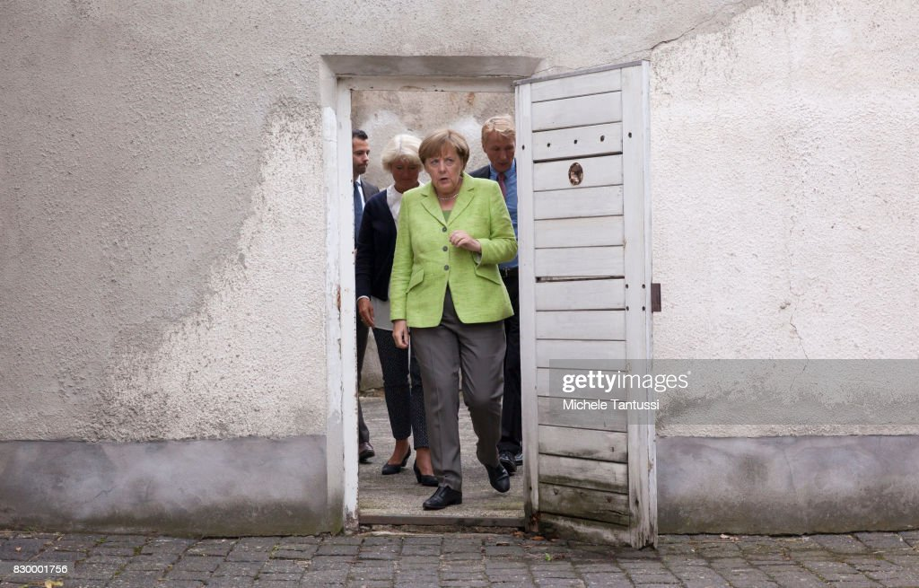 German Chancellor Angela Merkel visits with Monika Gruetters federal commissioner for Culture and Media the former prison of the East German, communist-era secret police, or Stasi, at Hohenschoenhausen on August 11, 2017 in Berlin, Germany. The State Security Service or Staatssicherheitsdienst, of the German Democratic Republic arrested and interrogated thousands of East Germans at the Hohenschoenhausen prison until the collapse of communist government and German reunification. Today the former Stasi prison Hohenschoenhausen is a museum and memorial.