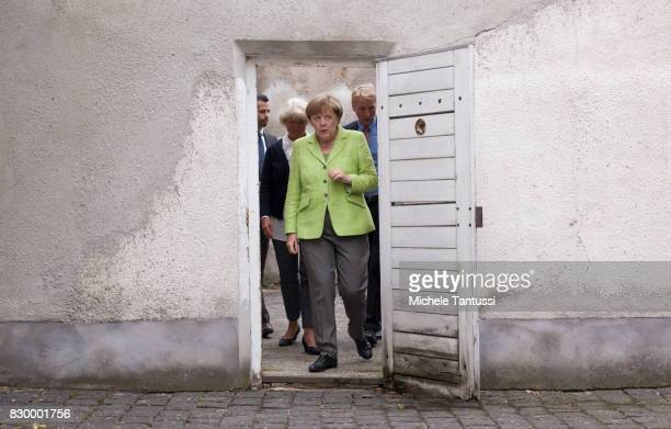 German Chancellor Angela Merkel visits with Monika Gruetters federal commissioner for Culture and Media the former prison of the East German,...
