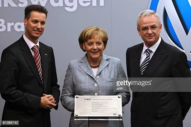 German Chancellor Angela Merkel Volkswagen' s CEO Martin Winterkorn and the president for Volkswagen in Brazil Thomas Schmall inaugurate the Center...