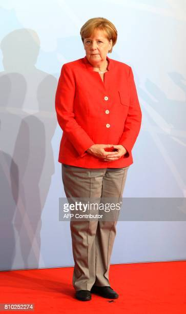 German Chancellor Angela Merkel waits before greeting heads of State at the start of the G20 meeting in Hamburg northern Germany on July 7 Leaders of...