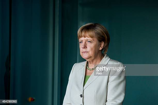 German Chancellor Angela Merkel waits for delegates at the German government Balkan conference at the Chancellery on August 28, 2014 in Berlin,...