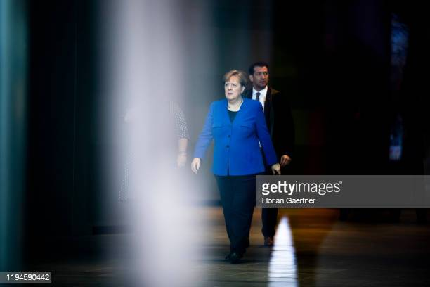 German Chancellor Angela Merkel waits for Denis Sassou-Nguesso , President of Congo, before the Libya Conference in the Federal Chancellery on...