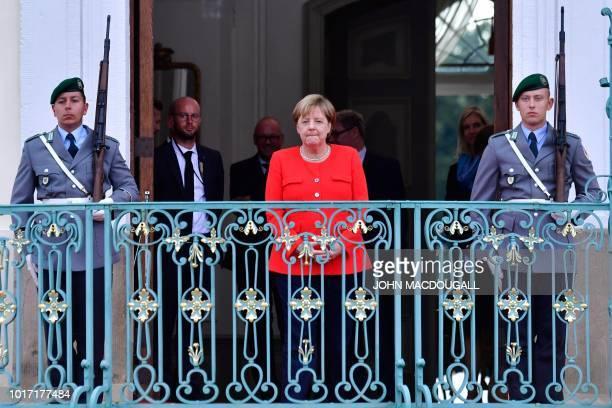 German Chancellor Angela Merkel waits for her guest Niger's President at Schloss Meseberg castle in Meseberg northeastern Germany where they meet to...