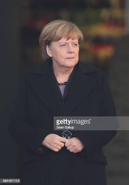 German Chancellor Angela Merkel waits for Honduran President Juan Orlando Hernandez to arrive for an official visit at the Chancellery on October 27,...