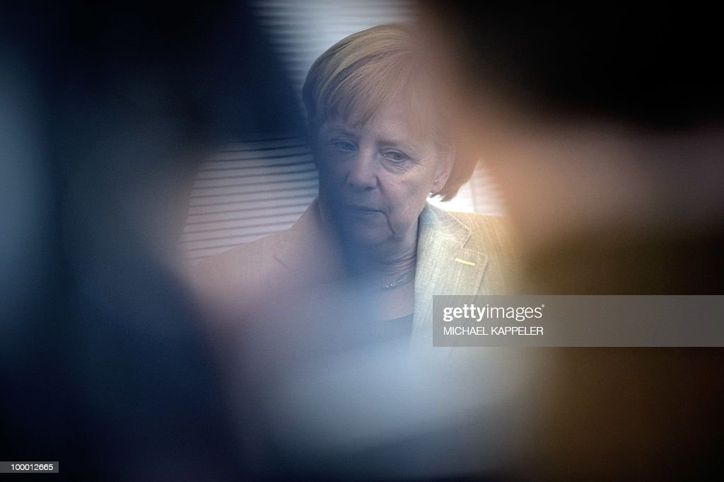 German Chancellor Angela Merkel waits for the beginning of a meeting with her conservative CDU party's parliamentary group on May 20, 2010 in Berlin. Merkel said during a conference on financial regulation she would lead a campaign for a tax on financial markets at the next summit of the Group of 20 major economies in June and called for international support.