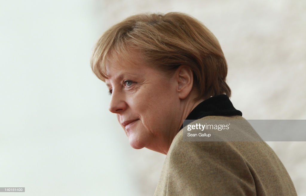 German Chancellor Angela Merkel waits to greet General Sheikh Mohammed bin Zayed Al Nahyan, the Crown Prince of Abu Dhabi, at the Chancellery on February 29, 2012 in Berlin, Germany. The Sheikh is on an official visit to Germany.