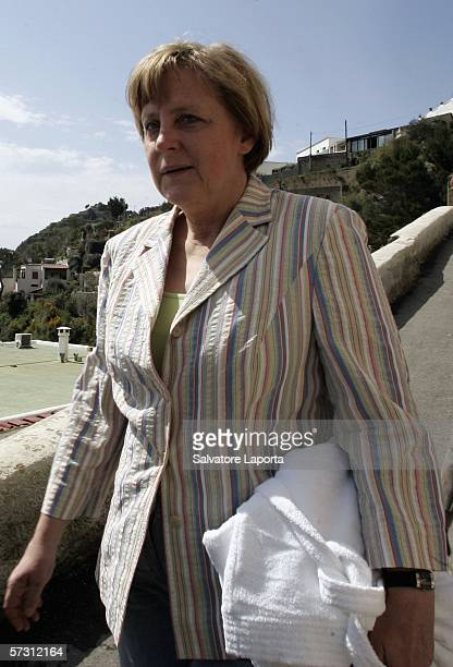 German Chancellor Angela Merkel walk beside the beach on April 11 2006 on the island of Ischia Italy
