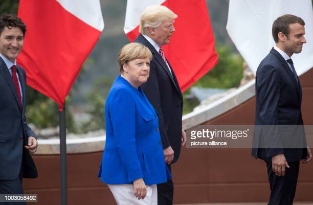 German Chancellor Angela Merkel walks next to US President Donald Trump Canada's Prime Minister Justin Trudeau and President of France Emmanuel...