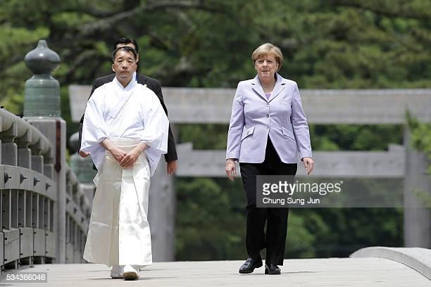 German Chancellor Angela Merkel walks on the Ujibashi bridge as she visits at the IseJingu Shrine on May 26 2016 in Ise Japan In the twoday summit...