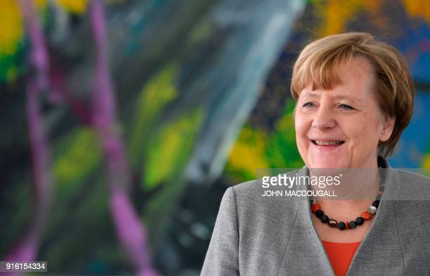 German Chancellor Angela Merkel walks out of her office to meet the President of the German Horticultural Association in the chancellery in Berlin...