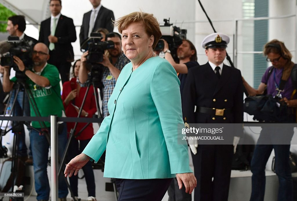 German chancellor angela merkel walks out of the chancellery to german chancellor angela merkel walks out of the chancellery to greet portuguese president marcelo rebelo de m4hsunfo