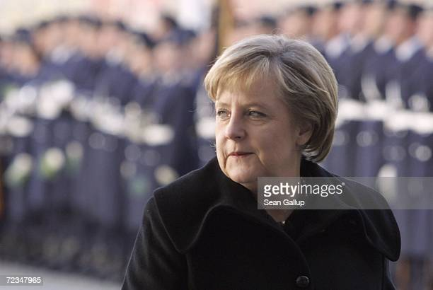 German Chancellor Angela Merkel walks past an honour guard prior to the arrival of Romanian Prime Minister Calin Tariceanu for talks at the...
