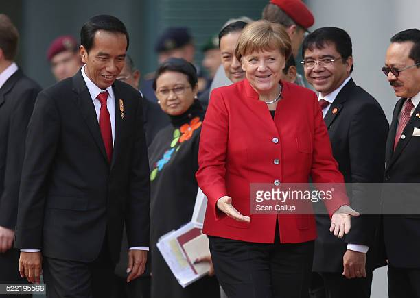 German Chancellor Angela Merkel walks with Indonesian President Joko Widodo upon his arrival at the Chancellery on April 18, 2016 in Berlin, Germany....