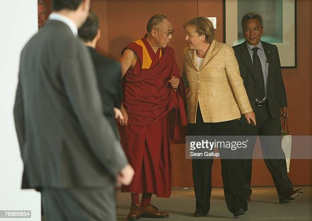 German Chancellor Angela Merkel walks with the Dalai Lama after private talks at the Chancellery September 23 2007 in Berlin Germany China has...
