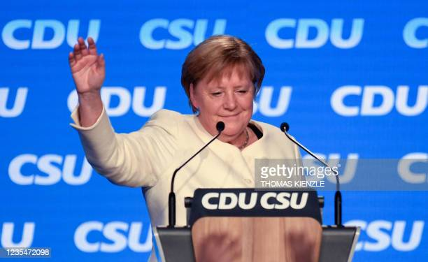 German Chancellor Angela Merkel waves after addressing the last rally of the conservative Christian Democratic Union CDU and its Bavarian...