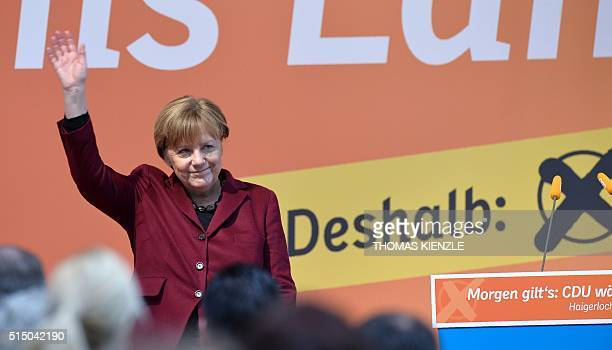 German chancellor Angela Merkel waves after delivering a speech at the last electoral meeting on March 12 2016 in Haigerloch southwestern Germany...