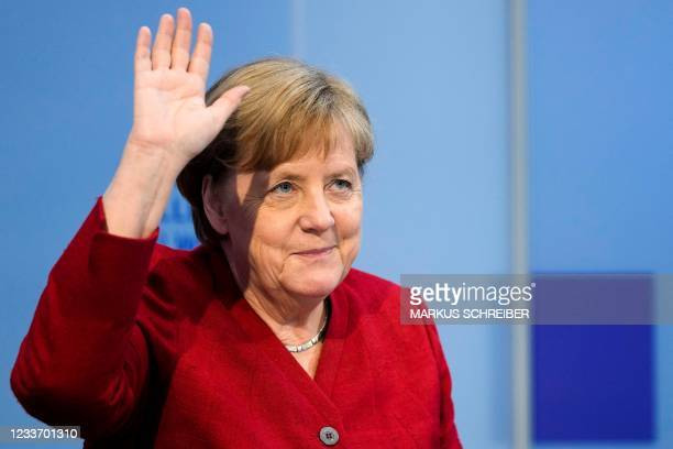 German Chancellor Angela Merkel waves as she arrives to attend a virtual discussion with students about the future of Europe at the Chancellery in...