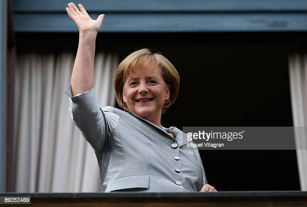 German Chancellor Angela Merkel waves from a balcony during the 'Tristan and Isolde' premiere of the Richard Wagner festival on July 25 2009 in...